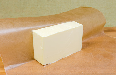 Piece of solid butter on waxed paper close-up