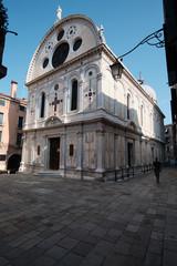 Venice, Italy, September 17, 2018 - Tourist walking alongside the church of Santa Maria Miracoli