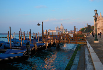 Venice, Italy, September 17, 2018 - Tourists walking in the early morning along the Venice Embankment