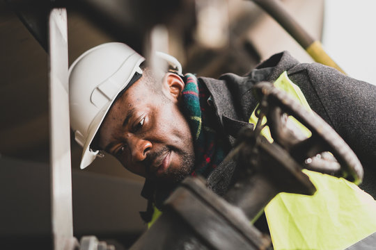 African American engineer at work on construction site