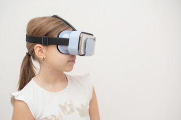child with virtual reality glasses. emotional portrait of child experiencing 3D gadget. selective focus.