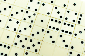 background of dominoes laid out on the table