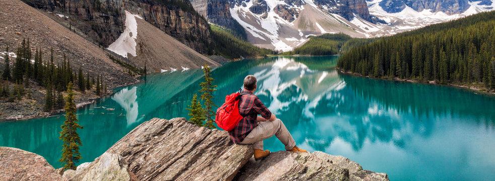 Hiking Man Looking at Moraine Lake & Rocky Mountains Panorama
