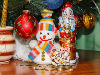 Christmas picture, greeting card with a pig, snowman and Santa Claus