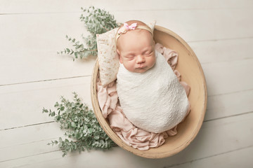 newborn girl on a white background Wall mural