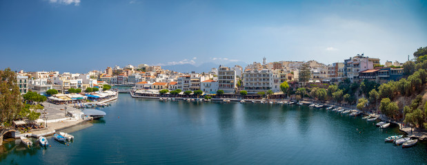 Lake in the middle of the city of Agios Nikolaos. A beautiful small town on the island of Crete, Greece.City architecture and tourist attractions.
