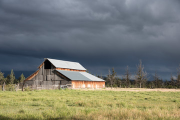 barn with ominous sky and clouds