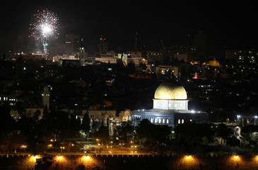 Fireworks light up the sky over the old city of Jerusalem during New Year celebrations