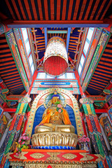 figure of Buddha and Prayer flag in the Five Pagoda Temple, Hohhot city, Inner Mongolia autonomous region, China