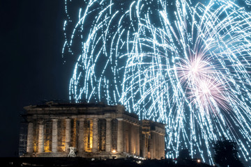 Fireworks explode over the ancient Parthenon temple atop the Acropolis hill during New Year's day celebrations in Athens