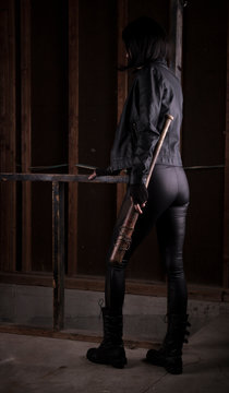 Sexy female assassin with a bat