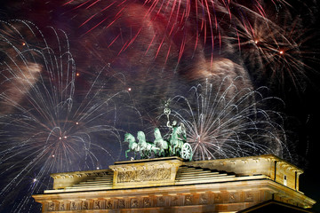 Fireworks explode over the Quadriga sculpture atop the Brandenburg gate during New Year celebrations in Berlin, Germany