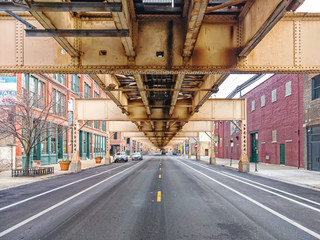 Lake Street underneath the elevated train in the Fulton Market neighborhood, east perspective. Main streets in Chicago, streets in Illinois.