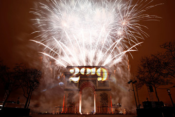 Fireworks explode during the New Year's celebrations at the Arc de Triomphe in Paris