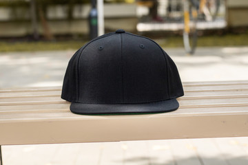 Blank snapback hat cap flat visor with black color in outdoor, ready for your mock up design or presentation your design project