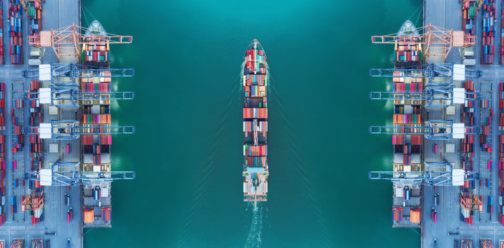 Aerial top view panoramic container ship moving pass sea port warehouse and crane ship working for delivery containers shipment, logistic import import or transportation concept.