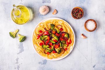 Pasta with broccoli, pepper, onion.