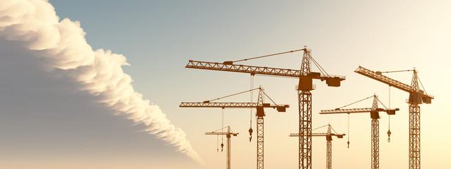 Baukräne vor einer Wolkenfront
