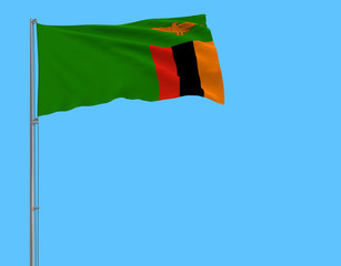 Isolate flag of Zambia on a flagpole fluttering in the wind on a blue background, 3d rendering.