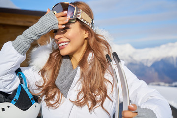 Close up portrait of a woman at a snow ski center.
