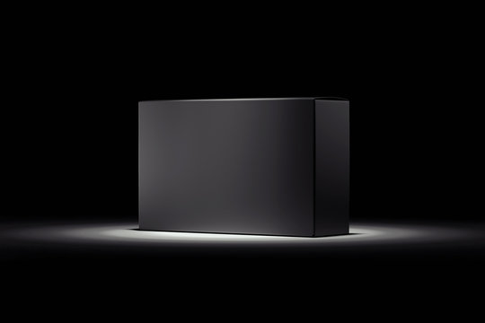 Isolated black realistic cardboard box on black background. 3d rendering.