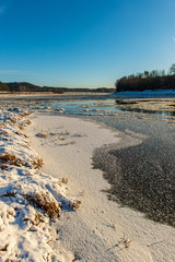 frozen ice and snow in river in winter