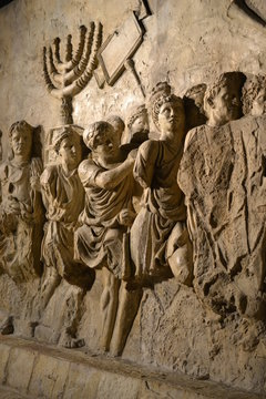Wall relief on arch of titus depicting Menorah taken from temple in Jerusalem in 70 AD - Israel history, Jewish war