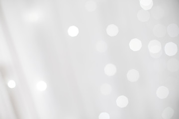 Blur photo of White christmas background with bokeh lights and snowflakes