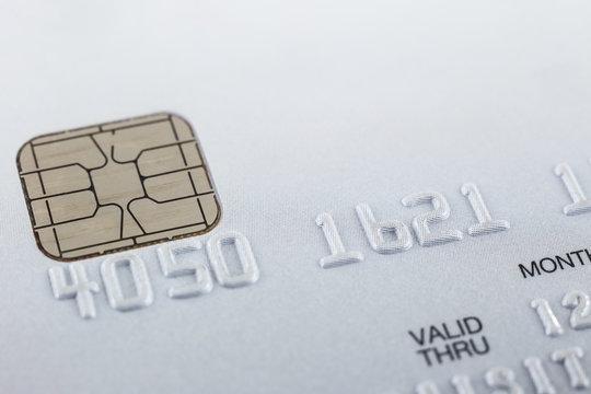 Silver credit card focus on embossed numbers.