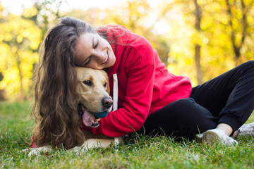 Young smiling woman with her cute dog