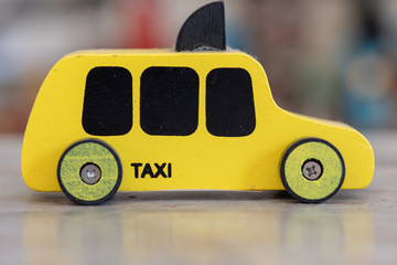 taxi sign on yellow cab