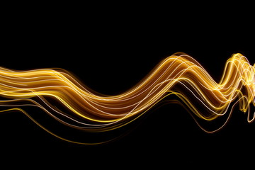 Light painting photography, gold swirls and waves of vibrant color, long exposure photo of fairy lights against a black background