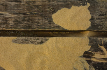 Old vintage wooden sign with sand beach. Top view, copy space. - Image