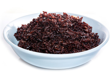 Brown rice, riceberry organic food  in white bowl Isolated and white background