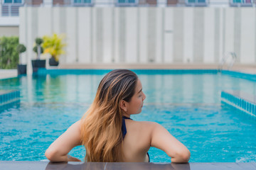 Portrait Asian sexy woman swimming at swimmingpool,thailand people,relax time