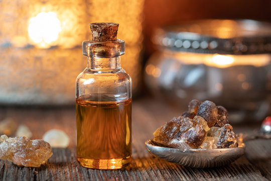 A bottle of frankincense essential oil with frankincense resin crystals