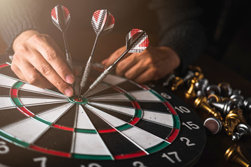 business strategy ideas concept business man hand hold arrow dart and goal board creativity image