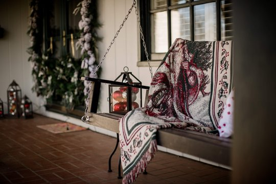 front porch with swing decorated for christmas