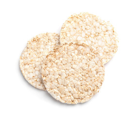 Crunchy rice cakes on white background, top view