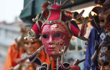 a red carnival mask