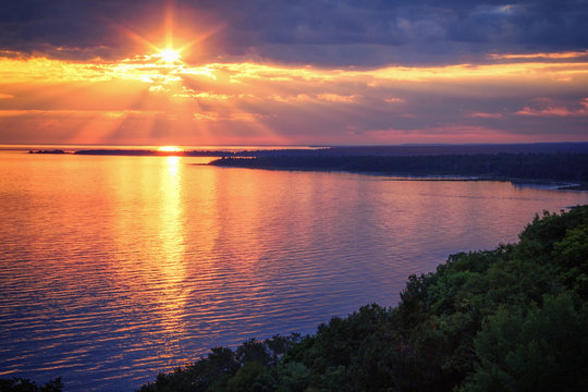Lake Michigan Coastline Sunset. A scenic view from the Cut River Bridge roadside park overlooking Epoufette Bay in Michigan's Upper Peninsula. Lakeshore background with copy space.