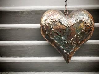 Metal heart on wood shutter