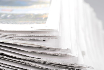 Heap of old newspapers, selective focus