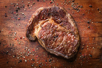 tasty and fresh, very juicy ribbey steak of marbled beef, on a wooden table. Wall mural