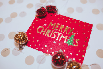 christmas card with gift box and balls with white brown background
