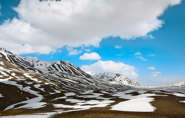 clouds over beautiful snowy mountains - images