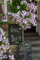 Sign Free Beer with small print, Fowey, England, Great Britain