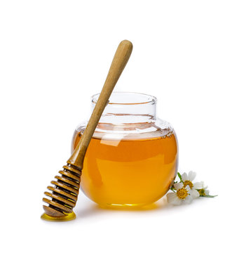 Honey bee in jar with honey dipper and flower isolate on white background, bee products by organic natural ingredients concept