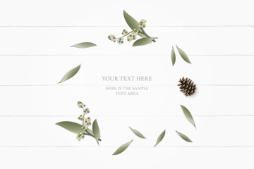 Flat lay top view elegant white composition paper botanic garden plant leaf flower pine cone on wooden background