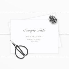Flat lay top view elegant white composition paper pine cone and vintage metal scissors on wooden background